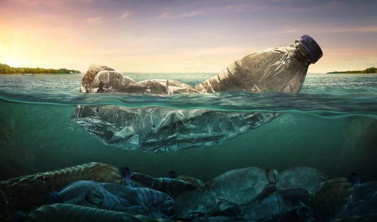 Plastic water bottle in ocean
