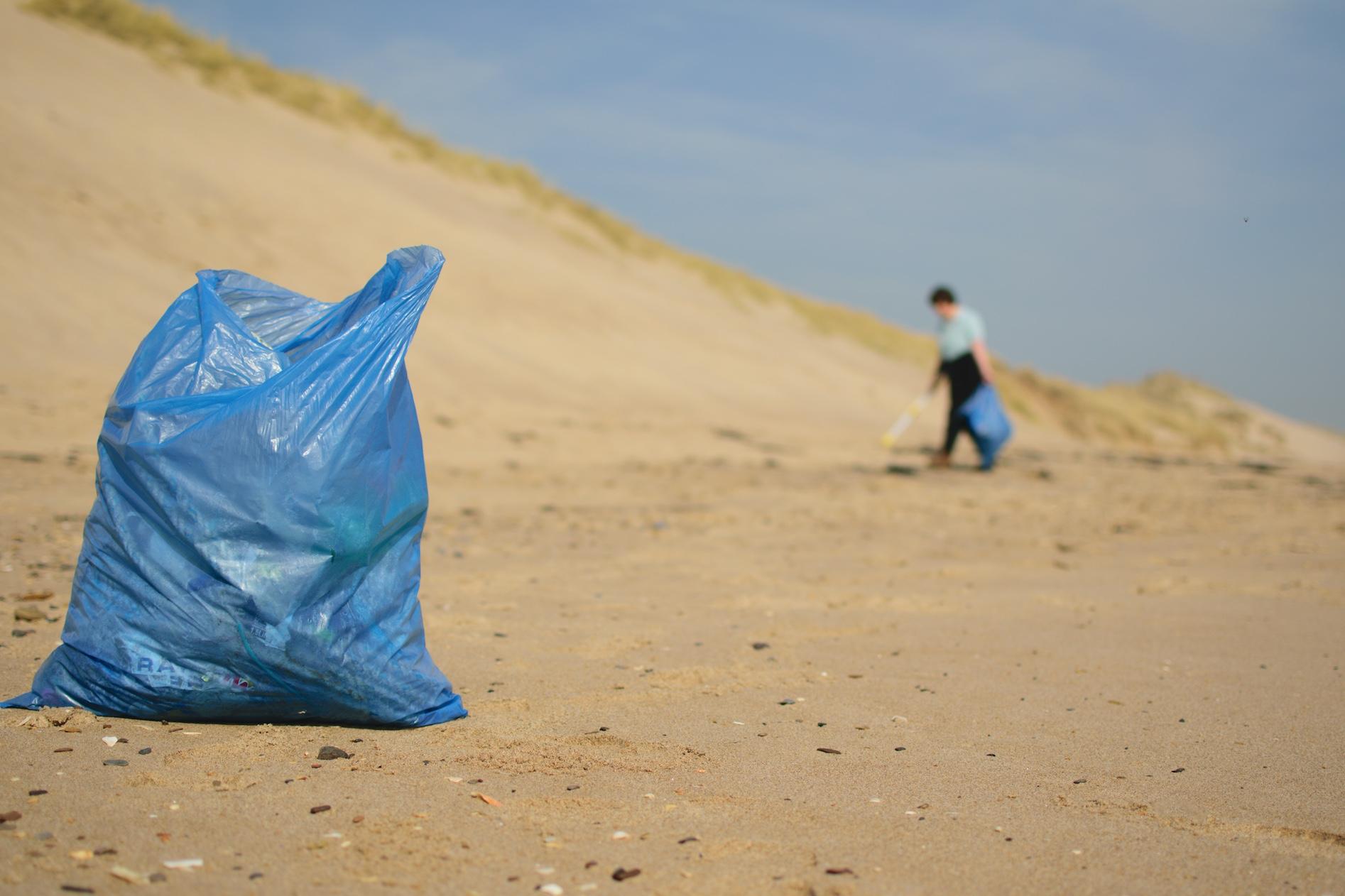 picking up beach trash