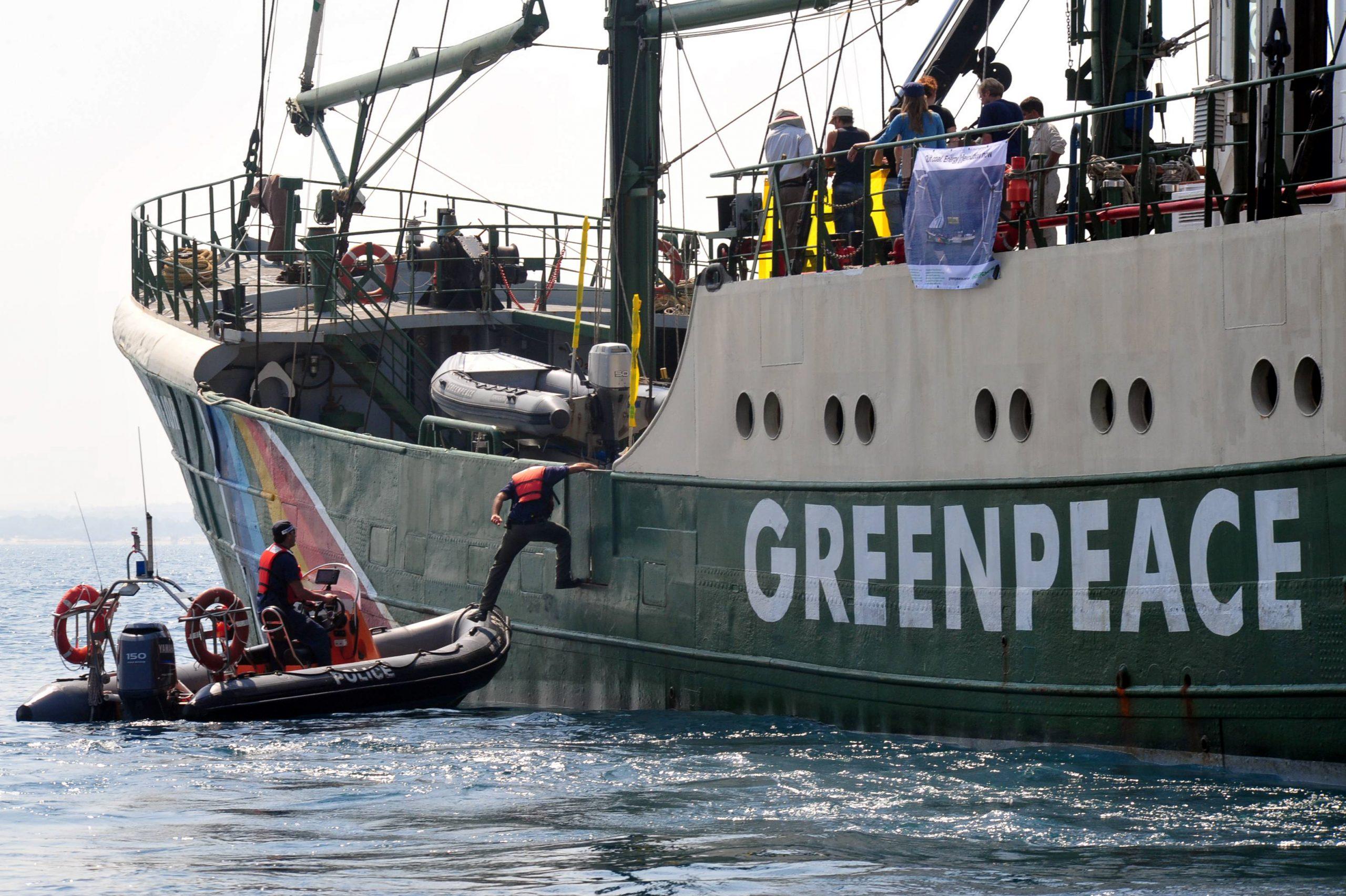 Greenpeace lowers member into water
