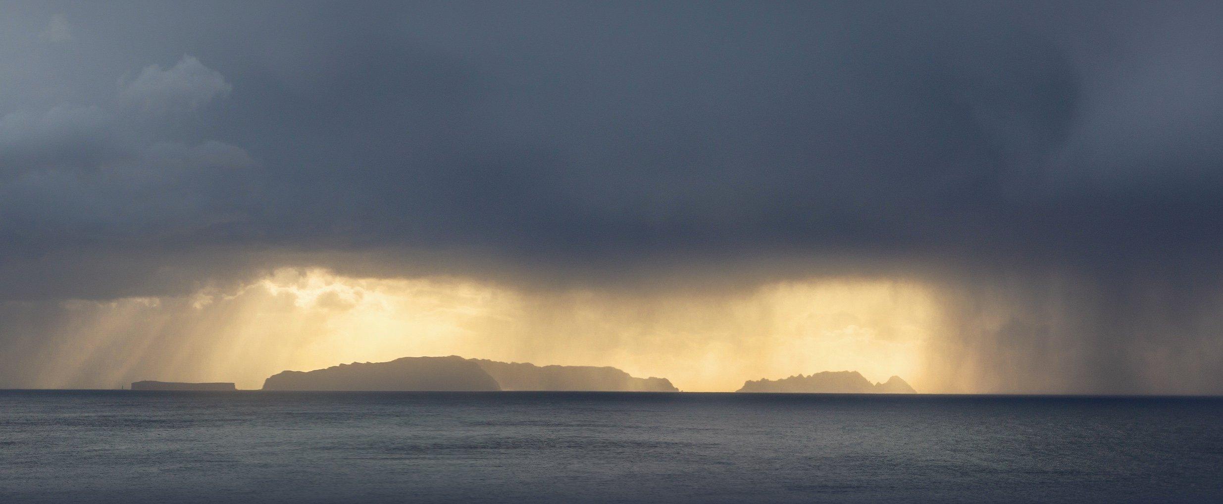 rain shower over the ocean
