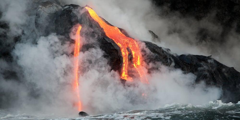 Hot lava stream is flowing into the ocean in Hawaii, Big Island.