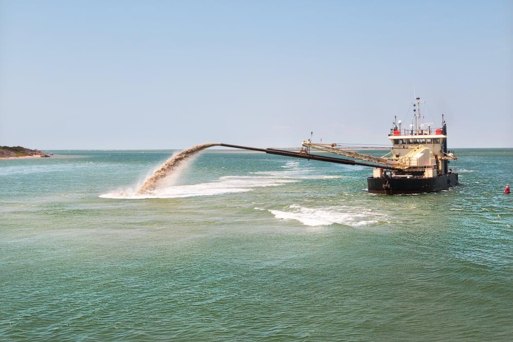 ocean dredger working on replenishing degrading shoreline